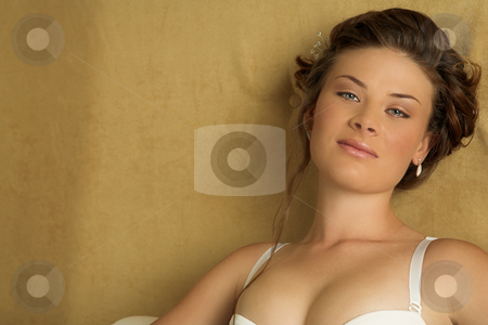 Lingerie#241 stock photo, Woman in underwear sitting on a bed. by Sean Nel