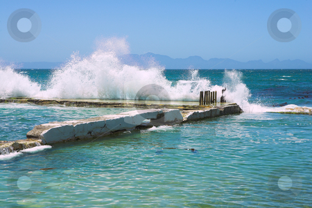 Wavebreak stock photo, Wave breaking against the harbor wall, Kalk Bay, Western Cape, South Africa by Sean Nel