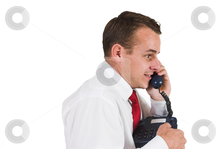 Tollie Booysen #21 stock photo, Businessman in black trousers, white shirt and red tie. Talking on the phone. by Sean Nel