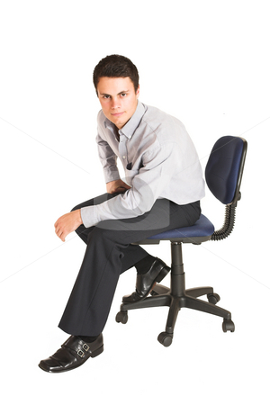 Businessman #100 stock photo, Businessman sitting on office chair. by Sean Nel