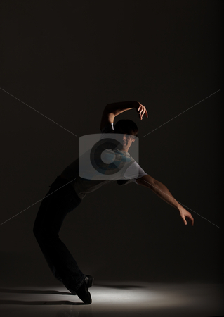 Tap Dancer stock photo, Young male tap dancer on his toes in the spotlight by Sean Nel