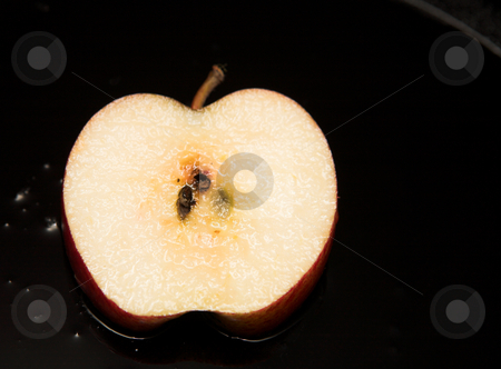 Fresh slice of fried apple stock photo, Fresh slice of fried apple dessert on a black pan covered in sauce by Sean Nel