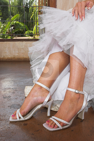 Bridal sandals stock photo, White sandals worn by bride by Sean Nel