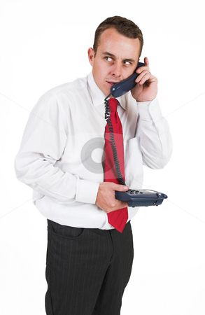 Tollie Booysen #19 stock photo, Businessman in black trousers, white shirt and red tie.Talking on the phone by Sean Nel