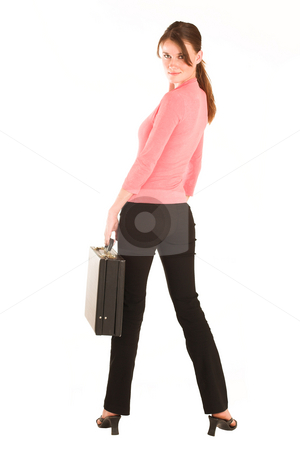 Business Woman #427 stock photo, Brunette business woman in  an informal light pink shirt.  Looking over her shoulder, holding a leather suitcase. by Sean Nel