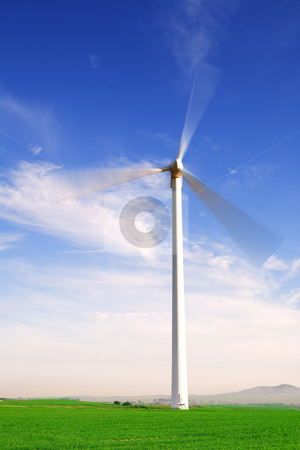 Wind powered turbine stock photo, Wind powered electricity generator standing against the blue sky in a green field on the wind farm. (movement on blades) by Sean Nel