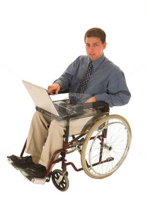 Businessman #142 stock photo, Businessman sitting in a wheelchair working on laptop by Sean Nel