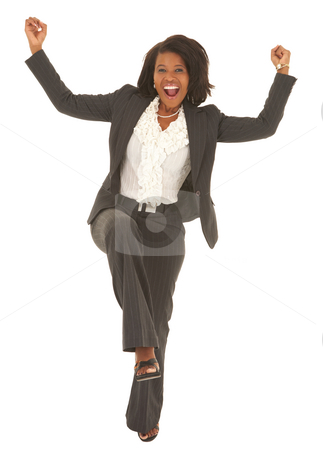 Sexy african businesswoman stock photo, Sexy young adult african businesswoman in a business suit on a white background, dancing. NOT ISOLATED by Sean Nel