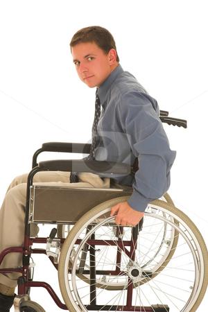 Businessman #125 stock photo, Man sitting in wheelchair. by Sean Nel