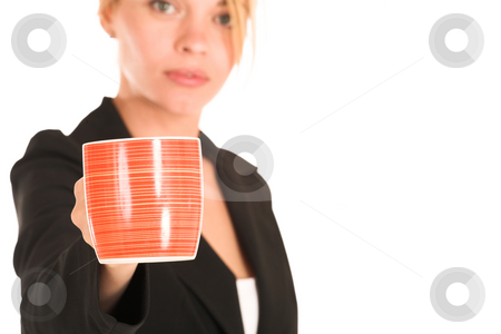 Businesswoman #252 stock photo, Blonde business lady in formal black suit. Holding a mug.  Shallow DOF, mug in focus, face out of focus.  Copy space by Sean Nel