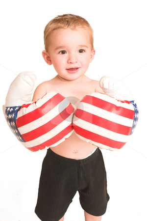 Clayton Booysen #1 stock photo, Todler standing with big boxing gloves. by Sean Nel