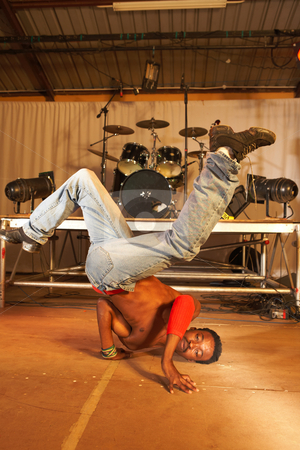 African freestyle hip-hop dancer stock photo, Single African freestyle hip-hop dancer at a training session on stage with instruments in the background by Sean Nel