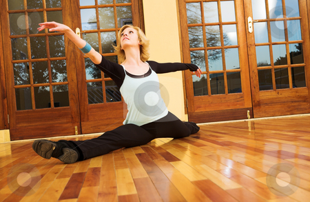 Dancer #38 stock photo, A Female Dancer practicing in her studio - in a split, on the floor by Sean Nel