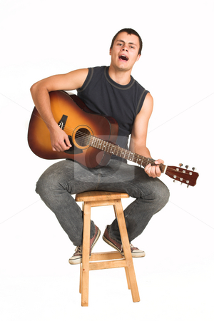 Franscois Booysen #12 stock photo, Young man with guitar.  Sitiing on a wooden chair, singing by Sean Nel