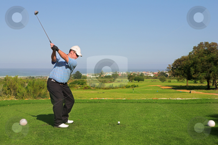 Golfer #65 stock photo, A golfer playing golf on a green.  Movement on the golf club by Sean Nel