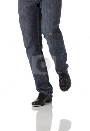 Single tap dancer stock photo, Single male tap dancer wearing jeans showing various steps in studio with white background and reflective floor. Not isolated by Sean Nel