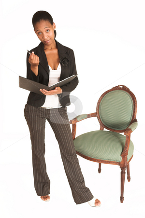 Mida Matsimela #11 stock photo, African business woman dressed in black jacket. Standing next to a chair holding a file and a pen by Sean Nel