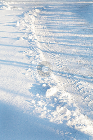 Munich #10 stock photo, Tracks of a vehicle on a road in Munich covered insnow.  Shallow DOF by Sean Nel