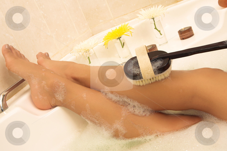 Woman #64 stock photo, Woman washing her legs in a bath. by Sean Nel