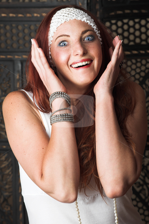 Female Fashion Model stock photo, Young female adult fashion model with natural red hair and freckles in a white summers dress and white headband (textured wooden background) by Sean Nel