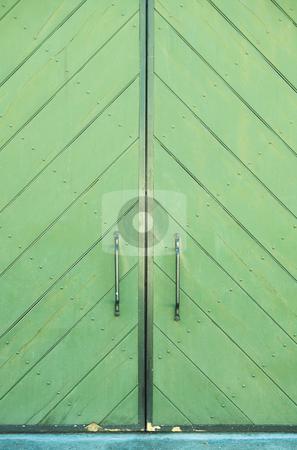 Green door of a building stock photo, Green door of a building with metal door handles and beautiful texture of paint by Sean Nel