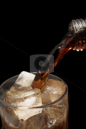 Glass #8 stock photo, Cooldrink is being poured into a glass full of ice, black background - copy space by Sean Nel
