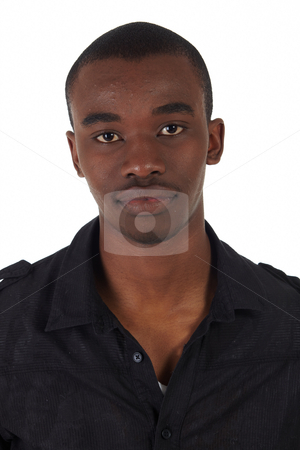 Black African businessman stock photo, Young Adult black african businessman wearing a dark smart-casual suit without a jacket on a white background in various poses with various facial expressions. Part of a series, Not Isolated. by Sean Nel