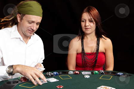 Card gambling stock photo, People playing cards, chips and players gambling around a green felt poker table. Shallow Depth of field, Focus on the Woman by Sean Nel