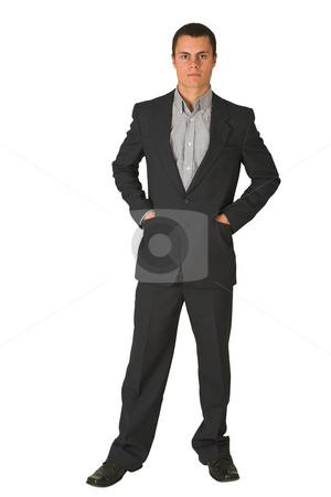 Businessman #227 stock photo, Businessman wearing a suit and a grey shirt.  Standing  with both hands in his pockets. by Sean Nel