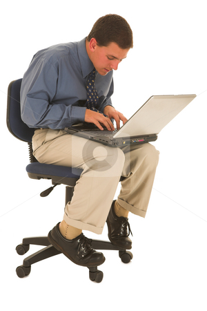 Businessman #52 stock photo, Man working on laptop on a office chair. by Sean Nel