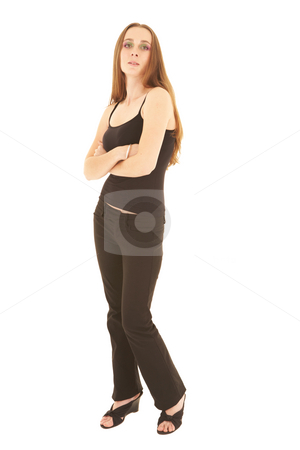 Sexy brunette businesswoman stock photo, Sexy young adult Caucasian businesswoman in a tight black sexy top on a white background. by Sean Nel