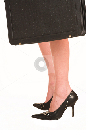 Charmaine Shoultz #15 stock photo, Legs of business woman, and black leather suitcase by Sean Nel