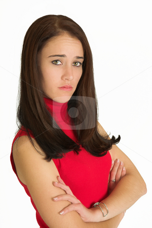 Business Woman #537 stock photo, Portrait of a brunette business woman, standing with her arms folded, looking worried. by Sean Nel