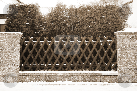 Munich #07 stock photo, Fence in front of a house covered in snow.  Sepia coloured photograph. by Sean Nel
