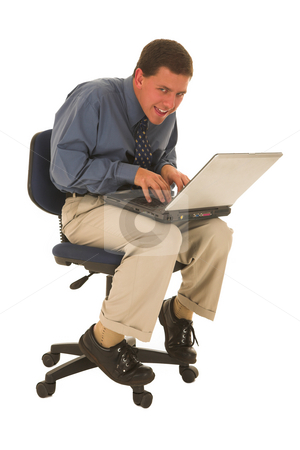 Businessman #51 stock photo, Man working on laptop sitting on a office chair. by Sean Nel