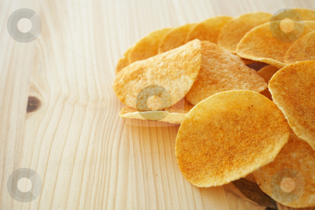 Chips and dip stock photo, Crispy golden brown potato chips on a wooden presentation plate (shallow depth of field) by Sean Nel