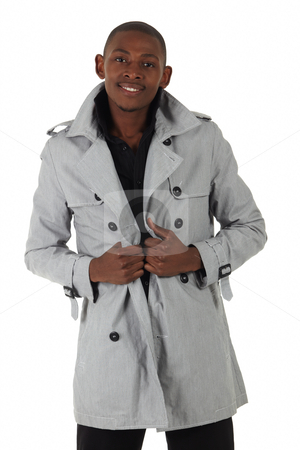 Black African Businessman stock photo, Young black african businessman in a formal suite and grey jacket and on a white background - NOT ISOLATED by Sean Nel