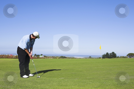 Golf #07 stock photo, Man playing golf aiming for hole. by Sean Nel