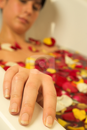 Woman #93 stock photo, Nude woman in a bath.  Shallow D.O.F - hand in focus, face out of focus.  Copy space. by Sean Nel