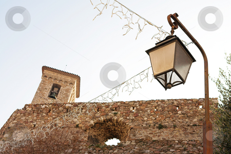 Building in Cannes stock photo, Old building with tower and street light in Cannes, France. by Sean Nel