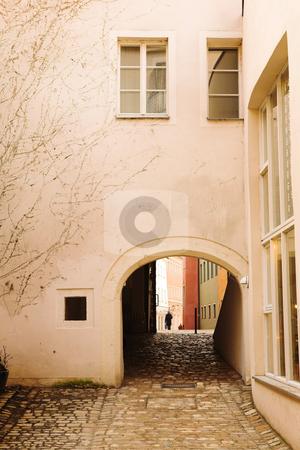Buildings in Regensburg stock photo, Buildings with windows and cobblestone walkway in Regensburg, Germany by Sean Nel