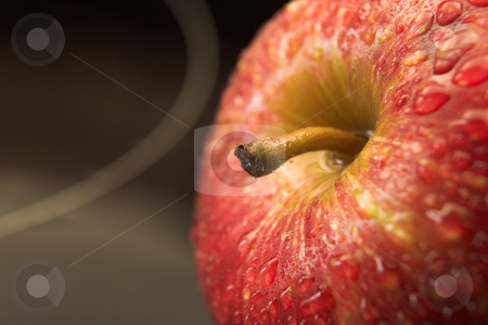 Fresh red apple stock photo, Fresh red apple with drops of water on a black glass backdrop - Shallow Depth of Field by Sean Nel