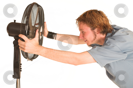 David Badenhorst #10 stock photo, Man with blue shirt cooling down in front of a fan. by Sean Nel