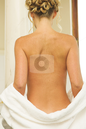 Nude #4 stock photo, Woman undressing in a bathroom, bathrobe over buttocks by Sean Nel