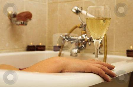 Woman #95 stock photo, Woman in a bath, holding a champagne glass. by Sean Nel
