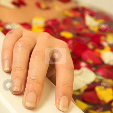 Woman #94 stock photo, Nude woman in a bath.  Shallow D.O.F - hand in focus, face out of focus.  Copy space. by Sean Nel
