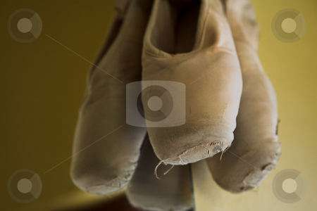 Pointe Shoes #3 stock photo, Pair of Ballet shoes hanging on the wall against a mirror  by Sean Nel