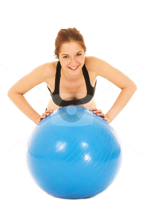 Woman with gym ball stock photo, Isolated young adult Caucasian woman doing push-ups on a blue gym ball by Sean Nel