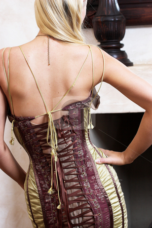 Fashion #2 stock photo, Blonde woman in fashionable lace-up bodice by Sean Nel