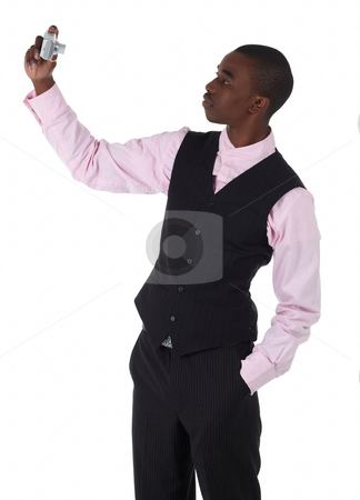 Black African businessman stock photo, Young Adult black african businessman wearing a dark smart-casual outfit without a Jacket, but with a pink shirt and a dark waistcoat taking a picture of himself on a white background in various poses with various facial expressions. Part of a series, Not Isolated. by Sean Nel